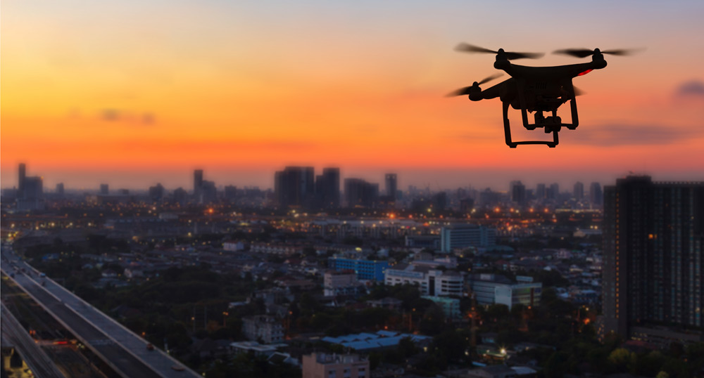 silhouette-drone-flying-cit